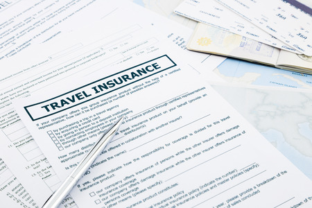recompense: travel insurance form, passport and tickets on world map paperwork, concept and idea for insurance business