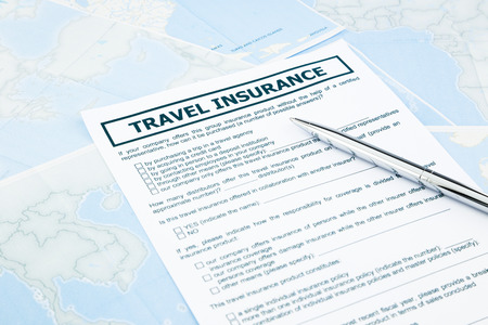 recompense: travel insurance form on world map, concept and idea for insurance business Stock Photo