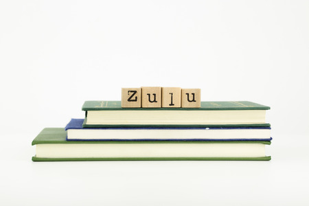 zulu word on wood stamps stack on books, language and study concept photo