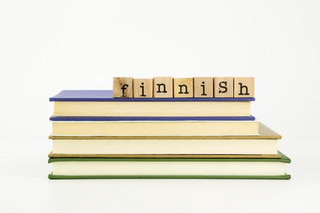 education in sweden: finnish word on wood stamps stack on books, language and academic concept