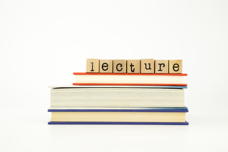savant: lecture word on wood stamps stack on books, knowledge and academic concept Stock Photo