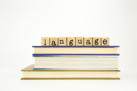 木製スタンプ スタック書籍、学術の研究の概念上の言語の単語 写真素材