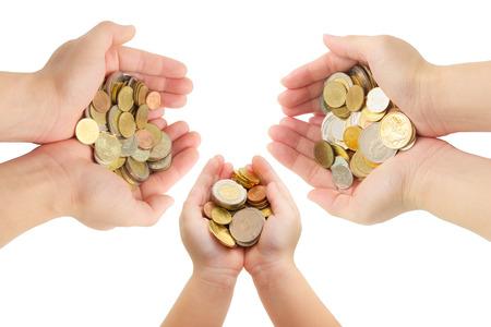 世界のコインを保持しているクローズ アップ人間手分離ホワイト バック グラウンド、家族計画、保険および保存のお金の概念