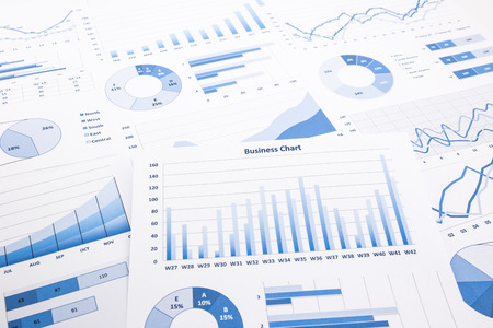 information analysis: blue business charts, graphs, reports and paperwork for financial and business concepts