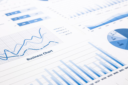 closeup blue business charts, graphs, statistic and reports for education and business concepts