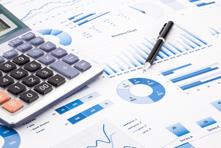 calculator and pen with blue business charts, graphs, infomation and reports background for financial and business concepts