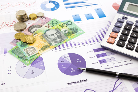 australia dollar currency on financial charts, expense cash flow summarizing and graphs background, concepts for saving money, budget management, stock exchange, investment and business income report Foto de archivo
