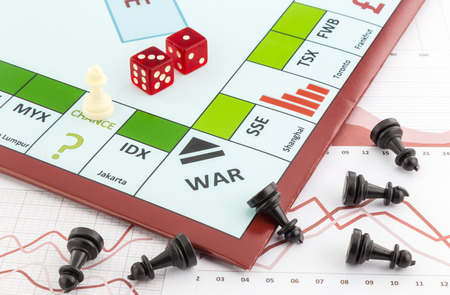 games of chance: Stock market board game with white piece places on chance area and black pieces fall on graph background Stock Photo