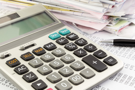 close up calculator on financial summary report