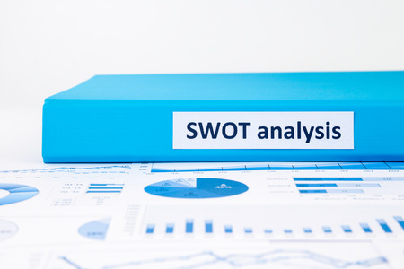Blue document binder of SWOT analysis place on business graph report concept to evaluate and planning projects Stock Photo