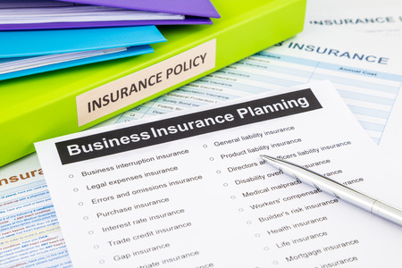 document management: Business insurance planning checklist with documents and binders, concept for risk management