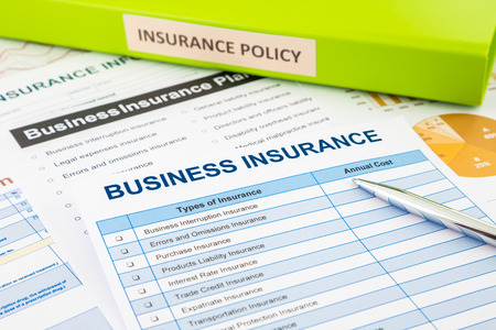 policy document: Business insurance planning with checklist forms and document binder, concept for risk management Stock Photo