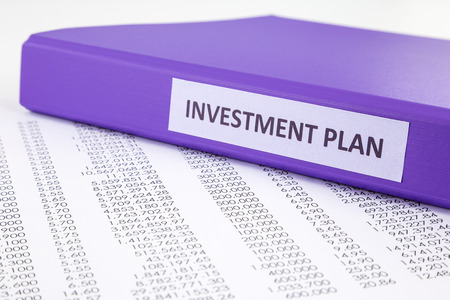 summarized: Financial report document with purple binder of investment plan, concept to financial accounting Stock Photo
