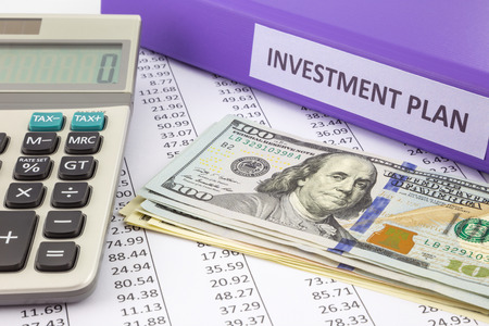 Money place on financial report with purple binder of investment plan,  concept for saving fund and return on investment photo