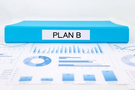 blue document binder with plan b word place on graphs and charts