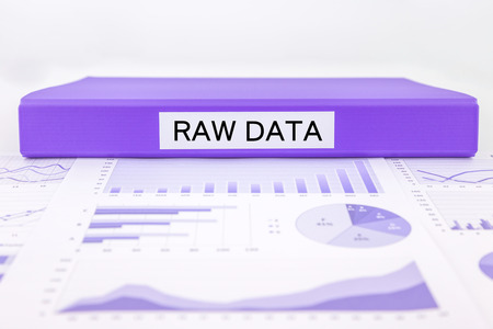 place of research: Purple document binder with RAW DATA word place on graphs, charts and research report Stock Photo