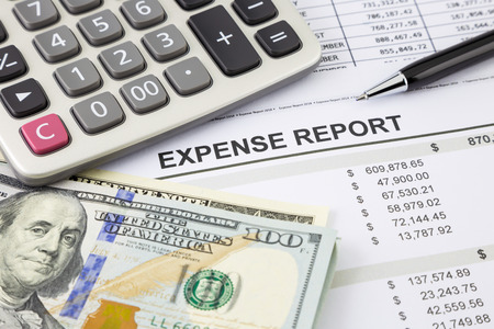 expense: Financial summary report with dollar banknotes and calculator, focus on Expense report word