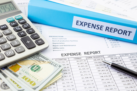 expense: Financial expense report with banknotes and calculator Stock Photo