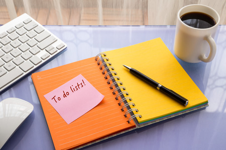 reminder concept: To do lists word on note pad stick on blank colorful paper notebook at home office table, reminder concept