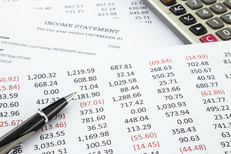Detail list of income and expense reports with income statement on background, concept for business accounting