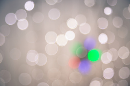 Defocused bokeh lights, abstract background with vignette