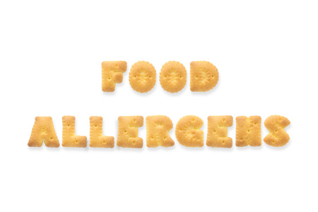 allergens: Collage of the capital letters word FOOD ALLERGENS. Alphabet cookie biscuits isolated on white background