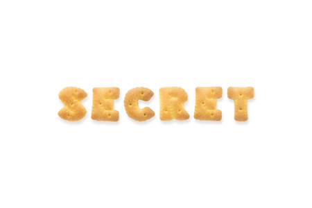 collage alphabet: Collage of the uppercase letterword SECRET. Alphabet cookie crackers isolated on white background
