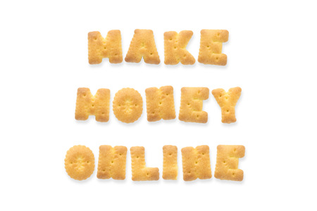 money online: Collage of the character word MAKE MONEY ONLINE. Alphabet cookie cracker isolated on white background