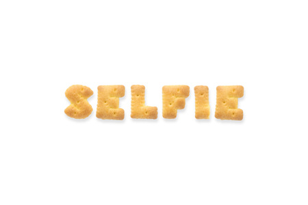 collage alphabet: Collage of the uppercase letterword SELFIE. Alphabet cookie biscuits isolated on white background
