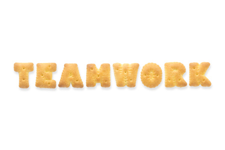 collage alphabet: Collage of the capital letters word TEAMWORK. Alphabet cookie biscuits isolated on white background
