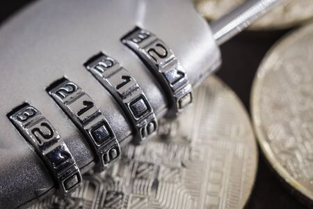 Close up 4 digits code number on silver combination pad lock on circuit board pattern of cryptocurrency. online banking, data protection, digital technology, cyber access, security encryption concept.