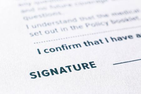 Close up word signature on business agreement form. Policy documents, registration, employment and commercial startup concept.