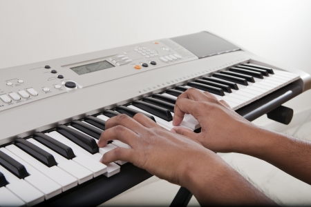 Musician playing electronic piano photo