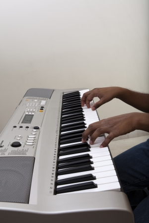 Pianist playing Electronic piano keyboard photo