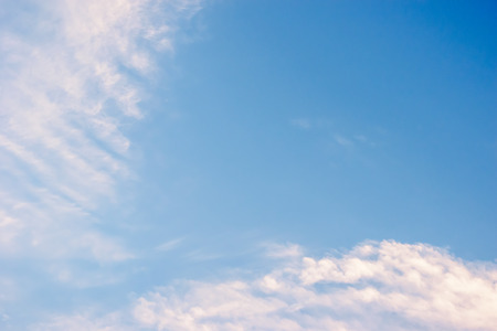 Light Blue sky with fluffy white clouds photo