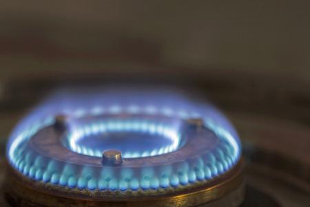 Closeup view of gas burner on kitchen stove photo