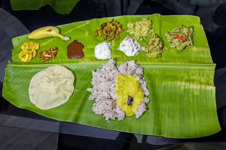 Traditional Indian meal from Kerala on banana leaf