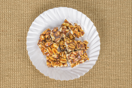 groundnut: Traditional Indian groundnut and jaggery candy Stock Photo