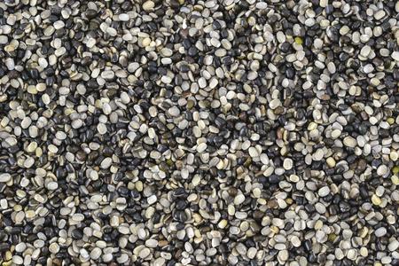 urad dal: Split black lentil (urad dal) filled in as background Stock Photo