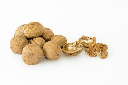 kernel: Whole and shelled walnuts and kernel on a white background Stock Photo