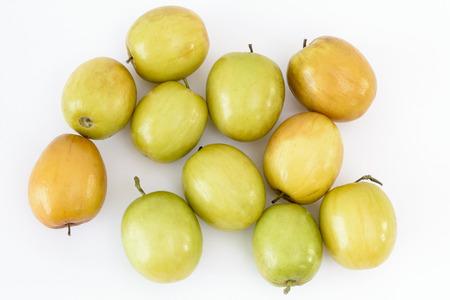 Indian plum or jujube (Ziziphus mauritiana) fruits on a white background