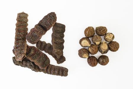 Dried Shikakai pods or soap bobs (Acacia Concinna) and Soapnuts {Sapindus emarginatus} on white Stock Photo