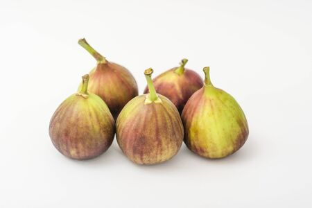 Fresh whole figs on a white background