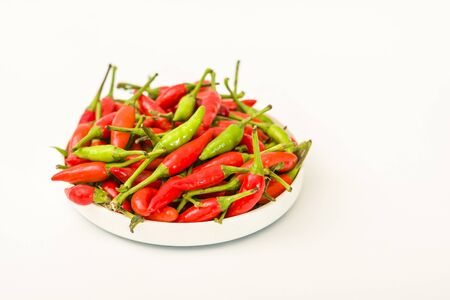 Birds Eye red and green chillies on a white background 写真素材