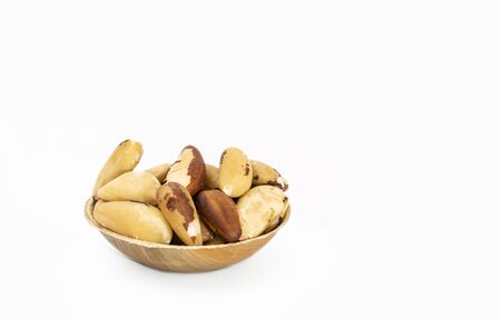 Bowl of Brazil nuts (Bertholletia excelsa) on a white background 写真素材