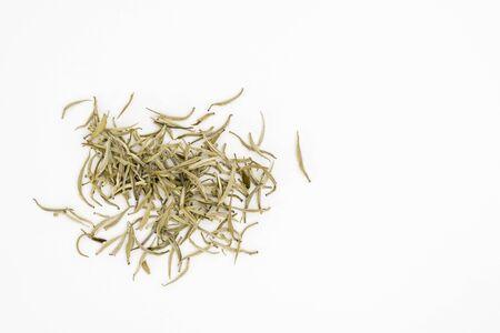 Silver needles white tea leaves or Baihao Yinzhen (Camelia sinensis) on a white background