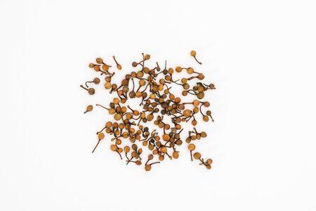 Indian rose chestnut or Nagakesar (Mesua ferrea) seeds on a white background