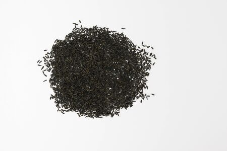 Blackseeds or Niger seeds (Guizotia abyssinica) on a white background