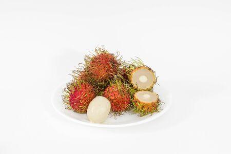 Plate of Rambutan fruits (Nephelium lappaceum) on a white background