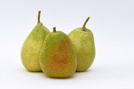 Closeup view of three pears on a white background
